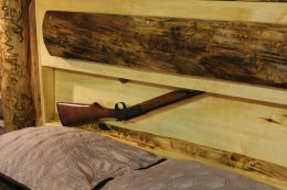 Photo showing Quick Draw Gun Bed hidden compartment with gun visible